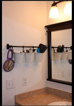 THIS Is exactly what our new bathroom looks like except white mirror... and white counter top  same light fixture too!