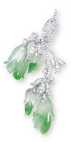 A JADEITE AND DIAMOND BROOCH  Designed as a branch of flowers, suspending five highly translucent carved jadeite blossoms or leaves of icy colourless material with bright green patches, to the diamond-set leaves and stems, mounted in 18k white gold, largest carving approximately 24.5 x 12.5 x 6.5 mm, 7.2 cm long