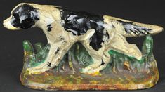 """HUBLEY SETTER DOORSTOP Cast iron, marked """"HUBLEY #280,"""" black & white setter pointed and ready for the hunt, stands in thick grass, wonderful realistic piece. 5 1/2"""" h. (Pristine Cond.)"""