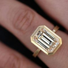 An incredible custom emerald cut diamond engagement ring by Erika Winters! I love the yellow gold bezel setting. An incredible custom emerald cut diamond engagement ring by Erika Winters! I love the yellow gold bezel setting. Emerald Cut Diamond Engagement Ring, Emerald Cut Diamonds, Diamond Wedding Bands, Diamond Rings, Diamond Jewelry, Diamond Cuts, Wedding Rings, Gold Jewelry, Jewellery Box
