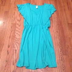 """VFish Green Dress Soft green V-neck boutique dress w/ short sleeves w/ ruffles.  95% cotton & 5% spandex. Elastic waistband. Measures 33.5"""" from shoulder to hem. NWOT Actual color looks most like 3rd picture. Vfish Dresses Midi"""