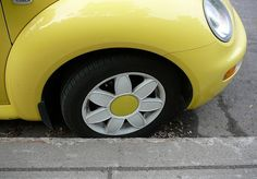 Yellow VW beetle with daisy wheels! So cute