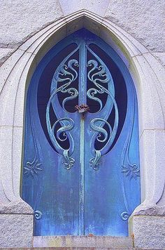 Blue door with intricate scrolls.