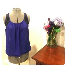 Purple Tank Top Vivid purple blouse with a black lace embellishment on the top. Kirra Tops Tank Tops