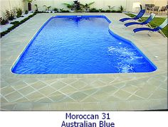 Moroccan 31 Leisure fiberglass pool from Texan Star Pools.  Love the lounge chairs and modern patio design.