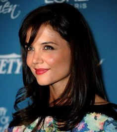 Just a touch of bangs lightens up Katie Holmes' thick hair.
