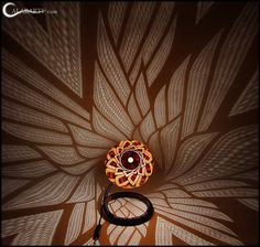 CALABARTE - Art of light. Unique handcrafted gourd lamps.   The patterned background is actually cast light from the lamp. Do want.