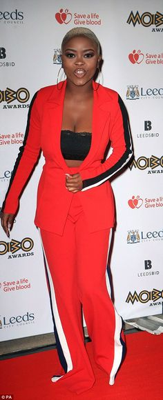Sports-luxe: Gifty Louise, who competed in last year's X Factor, kept it casual in a scarlet sports-trim trouser suit and racy crop top