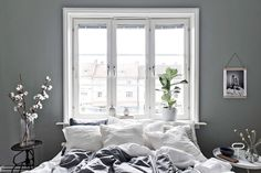 Gravity Home — Scandinavian apartment with grey bedroom Follow...