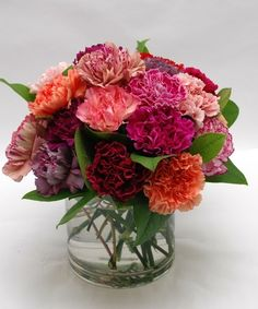 Carnival of Color Carnations-Two Dozen Mixed Color Carnations arranged in a vase.  A colorful confection everyone is sure to love!  Add Baby's Breath for a full yet light and airy feel. #NorfolkFlorist #VirginiaFlowers #GetWellFlowers