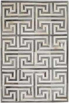 This gray and white greek key rug is comprised of charcoal gray and white cowhides that are sewn into the pattern. Please contact us at info@dallasrugs.com to purchase or for more options. Dallas Rugs - Your Only Rug Source With Many Resources