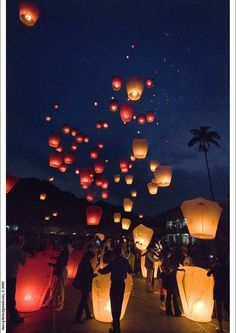What a GREAT idea! Releasing lanterns at a wedding celebration. Different colored lanterns for each side of the family, mixing together as they rise in the night sky.