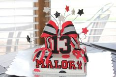 For Haley's Birthday! :) Gumpaste cheer bow, pom poms, and age. Everything else is fondant