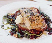 Herb & Lemon Roasted Salmon on a Bed of Roasted Potatoes & Sauteed Greens