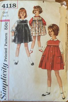 Vintage 4118 Simplicity (1961)  Size 5 Breast 23-1/2  Childs Jumper and Blouse: Blouse has front button closing, Peter Pan collar and three quarter length sleeves with elastic in casings forming self ruffles. Jumper is gathered to yoke and has front tuck with button trim and patch pockets. Yoke has back button closing. V. 1 jumper has square collar with rick rack or heavy lace trim. Collarless. V. 2 jumper has bias pockets. Pattern is complete with instructions. It is neatly cut and it a...