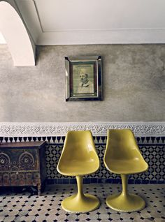 Black white tile + yellow chairs