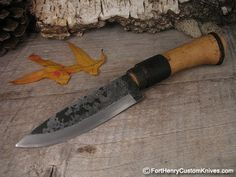 This is a traditional Seiryu Japanese Hunting knife in the Kuro-Uchi style finish.  Mastersmith Shosui Takeda hand forged the Aogami Super Steel blade in the popular American Drop Point profile.  The Wooden handle is Cord Wrapped and the Cord and Hard Wood handle are coated with a waterproof Resin from a Poisonous plant.  The knife also has a hand worked Iron Ferrule.