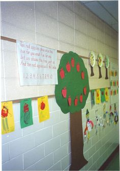 I also use this poem for number recognition.  Ten red apples grow on a tree Five for you and five for me Let us shake the tree just so... And ten red apples will fall below. 1,2,3,4,5,6,7,8,9,10  (Number 10 apples 1-10 to put on the tree.)