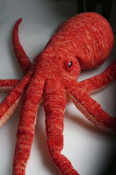 Opus the Octopus designed by Cate Carter-Evans :  pattern free at Knitty.com - Deep Fall 2014    Head is about 8 inches diameter, length about 36 inches, eye assembly is genius.