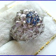 Blue Rhinestone Ring Brushed Silver Flower 1960s Vintage Jewelry http://www.greatvintagejewelry.com/inc/sdetail/blue-rhinestone-ring-brushed-silver-flower-1960s-vintage-jewelry/3415/670