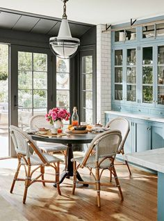 The sweet breakfast nook also has great views of the garden and is right inside the large kitchen. Don't the bistro chairs tie in nicely with the blue cabinets?