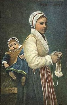 Babywearing Swede. Looks a tad awkward. I guess it's the baby version of side saddle?