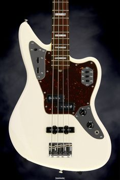 Fender Standard American Jaguar Bass. 4-string Electric Bass with Alder Body, Maple Neck, Rosewood Fingerboard, P-J Pickup Configuration, and Active EQ Circuit - Olympic White