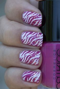 Pink, zebra print, sparkle... What more could you ask for in finger nail art