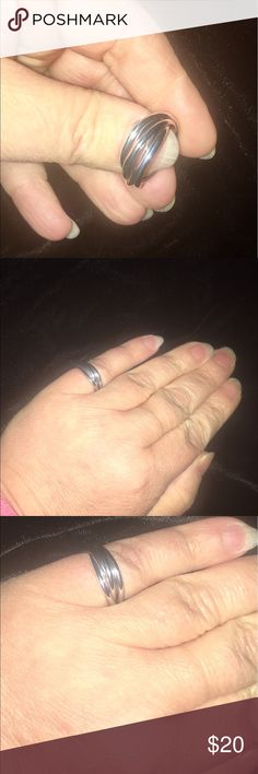 Avon Sterling silver rolling ring size 5 Super fun Sterling silver rolling ring by Avon. Size 5. If you notice in some of my other pics where my hand is visible, I wear one on my middle finger. There are five small rings interwoven so that when you put it on, they continually glide over each other. I love my ring. This size ring is for a more slender hand. Avon Jewelry Rings