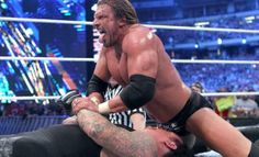 Triple H pinning The Undertaker after delivering the Tombstone Piledriver at WrestleMania XXVII. The Undertaker somehow kicked out and would win the match to go 19-0 at WrestleMania. http://theunofficialwweblog.tumblr.com/post/79170833757/27-days-left-number-28-triple-h-vs-the