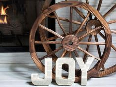 You could do a lot more with this idea!  Decoupaged Letters - 10 Rustic-Chic Holiday Decorating Ideas on HGTV