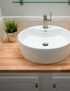 Pristine and chic, this charming bathroom renovation turns a drab space into something wonderful. The result is absolutely beautiful!
