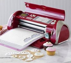 Create professional-looking cakes, cupcakes, cookies is as easy as pushing a button, thanks to the Cricut Cake Decorating Machine. This electronic cutter quickly trims sheets of gum paste, fondant or frosting into the shapes you choose. Cricut Cake, Baking Supplies, Baking Tools, Baking Products, Cake Decorating Tools, Cookie Decorating, Cake Machine, Cutter Machine, Baking Gadgets