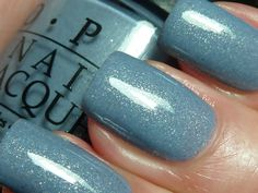 OPI - I Don't Give a Rotterdam! Blue with silver micro glitter. Must get this nail polish for winter. It's so pretty!