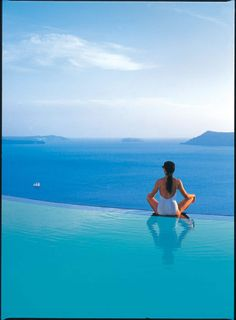 Infinity pool overlooking Aegean Sea at Perivolas Luxury Hotel, Santorini, Greece