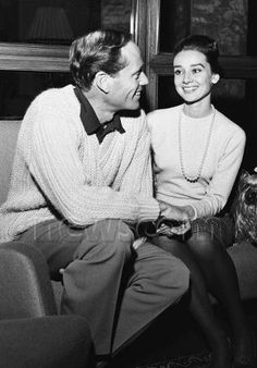 Mel Ferrer photographed with his wife Audrey Hepburn and Mr. Famous byZwirn in Rome (Italy), on January 08, 1960. Audrey was wearing: Skirt:I. Magnin(of wool,herringbone, of the collection for the Autumn/Winter 1958/59). Pearl necklace:Bvlgari. Stockings:Givenchy(of his collection for the Autumn/Winter 1959/60). Shoes:Salvatore Ferragamo.