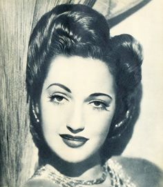 Dorothy Lamour, 1943 - adore her tall updo. #vintage #1940s #actresses #hair