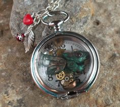 Polymer clay dragon, Swarovski crystal chatons & little watch cogs  Non working pocket watch pendant looking-glass-jewellery & facebook