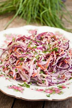 Coleslaw of, op z'n Nederlands     1/4 white cabbage     1/4 red cabbage     1 carrot     1 red onion     1 green onion     1/4 c yoghurt     1/4 c mayonaise     3 TB vinegar     2 TB sugar     1 tsp salt pinch pepper