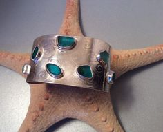 English seaglass cuff - 7 teal/torquoise color bezel seaglass treasures on Sterling silver cuff