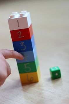 Quick September Math Game or for use later with tricky teens Players roll a die and grab the Lego with the matching numeral. Players must stack their legos in order and get each number to win. If player rolls a number they already have they skip a turn.