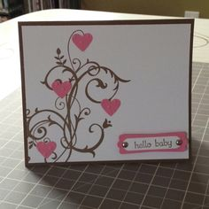 """Card Stock: Soft Suede, Whisper White, Regal Rose / Ink: Soft Suede  / Cool Tools: Modern Label Punch, Word Window Punch, Small Heart Punch, Big Shot, Perfect Polka Dots Embossing Folder  / Stamps: Baroque Motifs, Teeny Tiny Wishes  / Embellishments: 3/16"""" Silver Brads"""