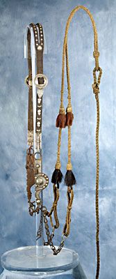 """An extraordinarily rare and marked headstall and bit sold for $14,000 in 2008. It was made by Alfred J. Schell and is marked """"A J Schell"""" on both the inside of the bridle silver hanger clasps as well as the inside cheek of the spade bit. This is one of only a handful of Schell silver mounted bridles and the only known """"signed"""" example."""