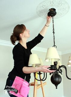 Pretty Handy Girl | Electrician on on ladder