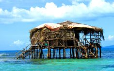 "Floyd's Pelican Bar is definitely one of the coolest spots on the island --quite possibly one of the best in the world. The rustic bar on stilts is located on Jamaica's South Coast, a quarter mile out to sea, between Black River and Treasure Beach. It's the perfect spot to relax, sunbathe and enjoy a ""well-cold"" Red Stripe beer or some Appleton rum."