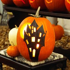 A Haunted Mansion--Creating this spooky haunted mansion pumpkin only looks difficult! Get the free pattern to create this wow-worthy pumpkin. (link to pattern provided).