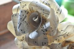 Set of 6 vintage music note paper flowers on stems.    Awesome set of paper flowers on stems. This listing is for a set of 6 paper roses that are