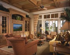 Love this family room, focused around a beautiful entertainment center.