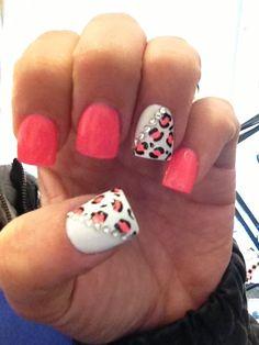 Cute nails. Salmon colored nail polish, white nail polish, rhinestones, and leopard print.
