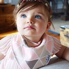 Could she be any more gorgeous?! We're loving Skyler in our triangle bib from our new Blush Set!  PC: @babyblueskyler